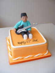 Boy-playing-guitar-cake