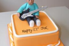 Boy playing guitar cake
