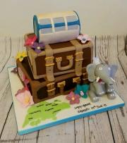 Suitcase travel engagement cake