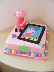 Peppa-and-tablet cake