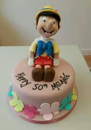 Ladies 50th Pinocchio birthday cake
