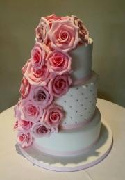 Pink rose cascade wedding cake