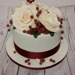 Berries and roses wedding cake