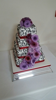 Square rose cascade wedding cake