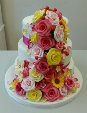 Colour rose and berries cascade wedding cake