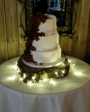Burgundy flower cascade superhero wedding cake