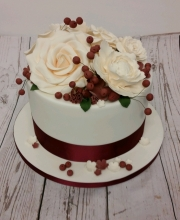 Berries and roses wedding cake